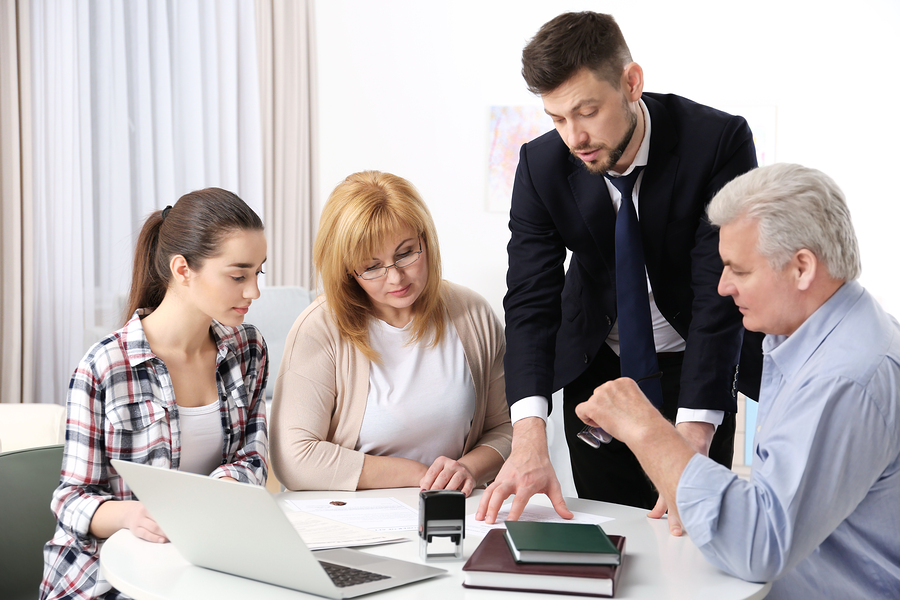 A younger couple and an older couple discussing a durable power of attorney in Phoenix Arizona